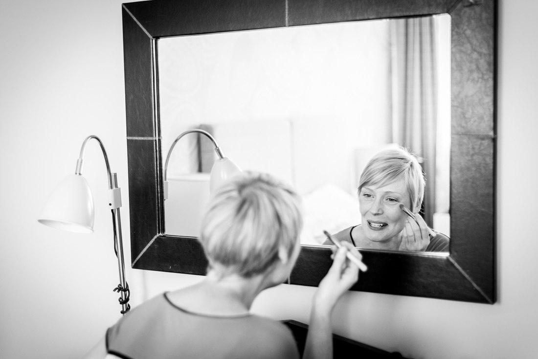 bride putting on make up in Warwick