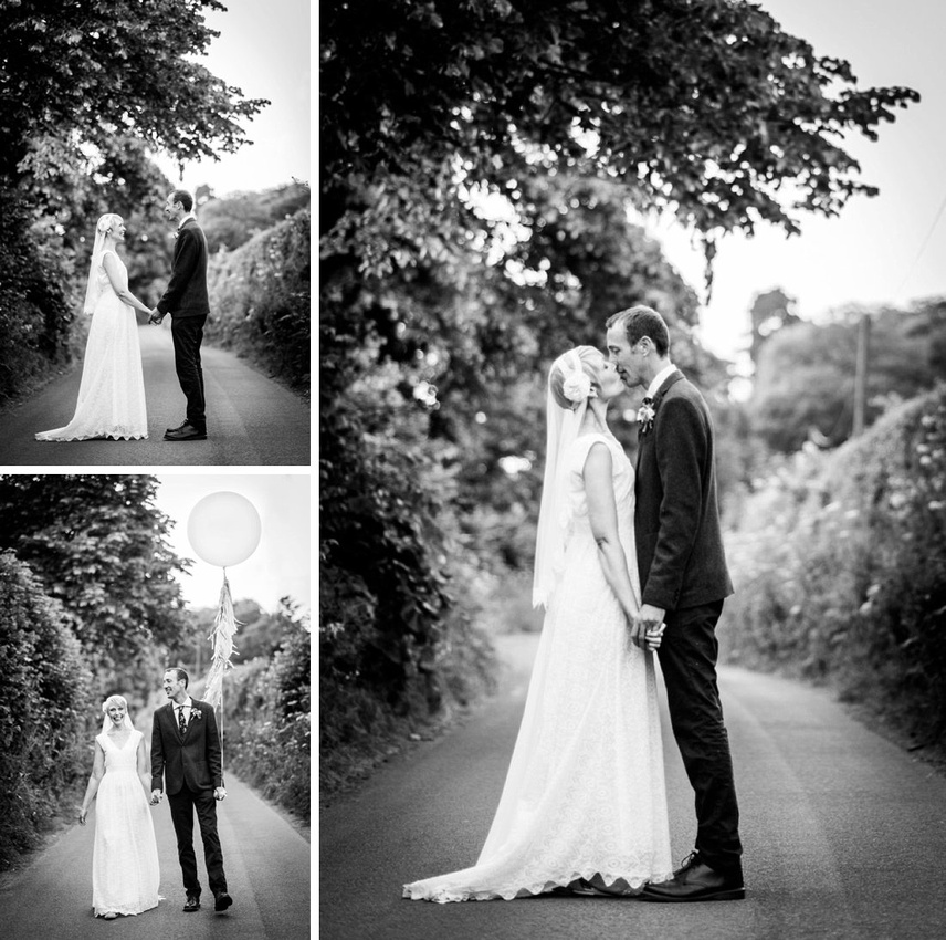 bride and groom walk down country lane in Warwickshire