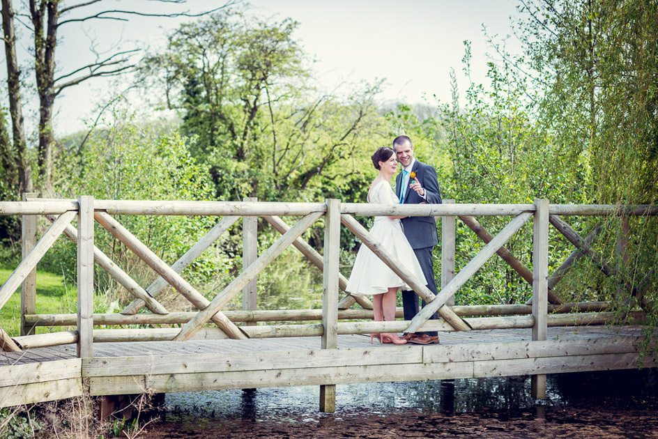 bride and groom on the bridge at Wootton Park