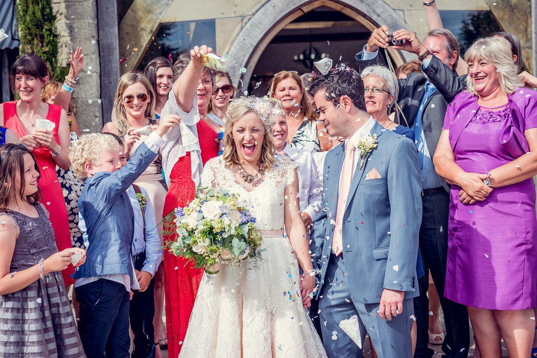 guests throwing confetti at Cripps Barn wedding