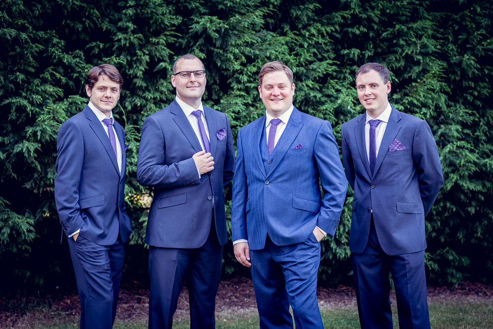 groom and groomsmen in blue suits at Ettington Chase