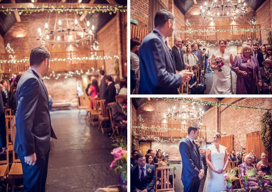 Wedding Photography at Curradine Barns in Worcestershire bride coming down aisle with mum