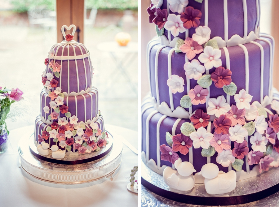 Wedding Photography at Curradine Barns in Worcestershire  bride made cake purple flowers lovebirds