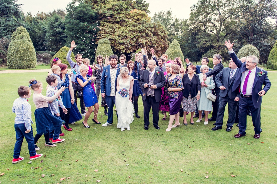 Wedding photography at Highbury Hall in Birmingham throwing confetti