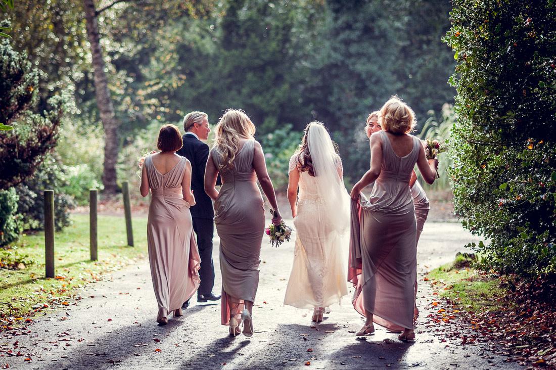 bride walking to Autumn wedding in Jenny Packham dress