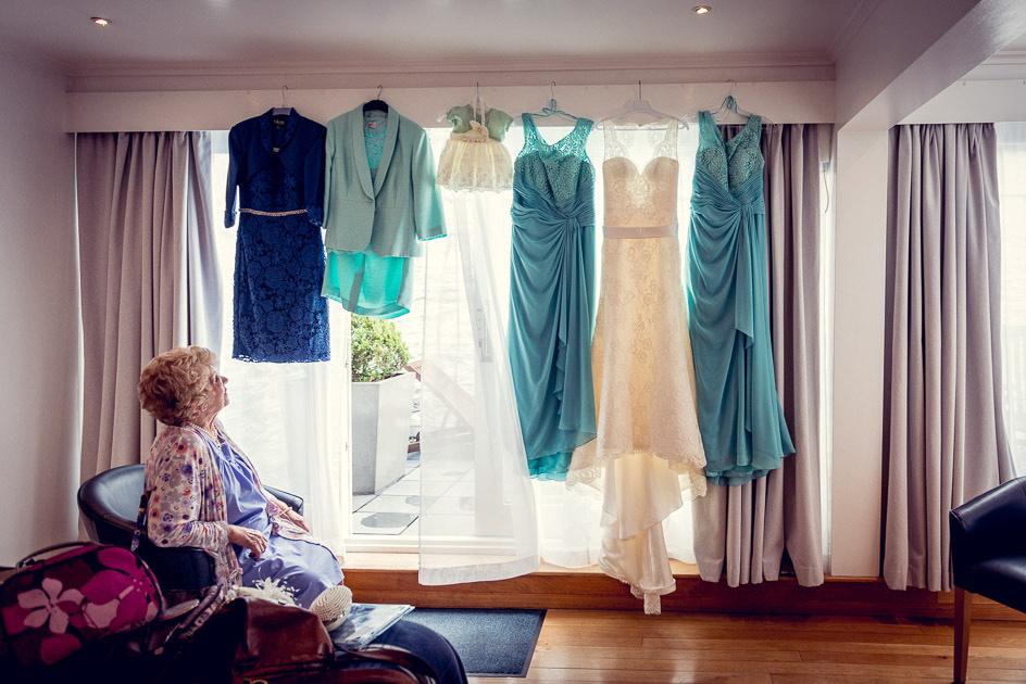 grandma looking at bride's dress at Castle Deudraeth
