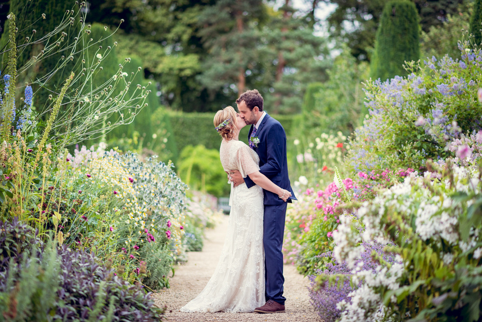 bride and groom in Hidcote Manor's long border