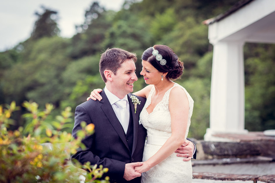 bride and groom portrait by the Watch House at Portmeirion