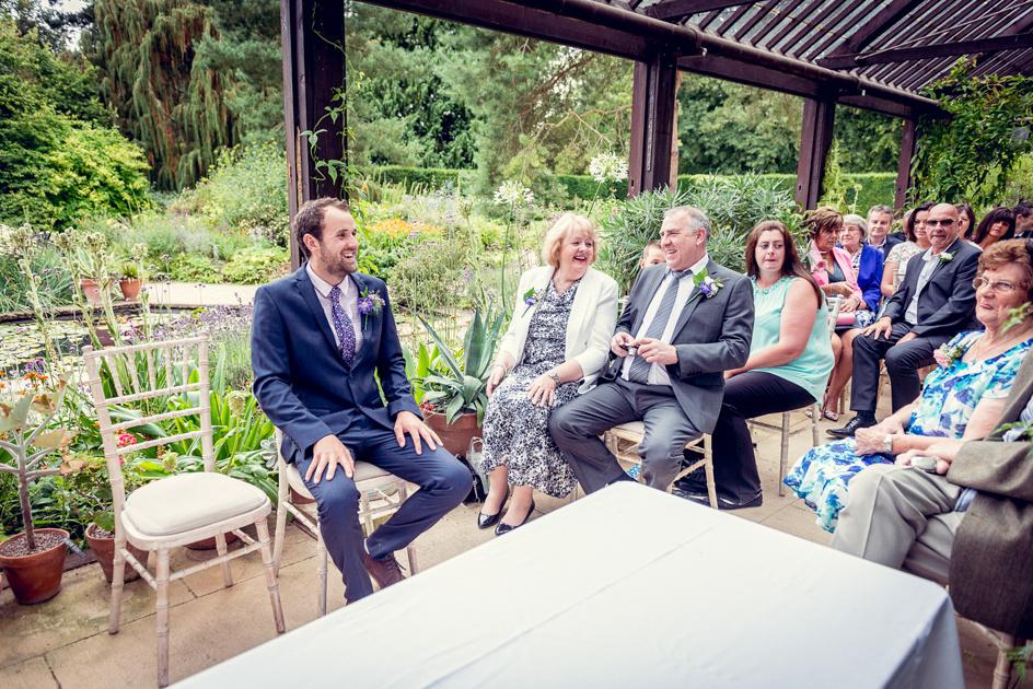wedding ceremony in Hidcote Manor Plant House