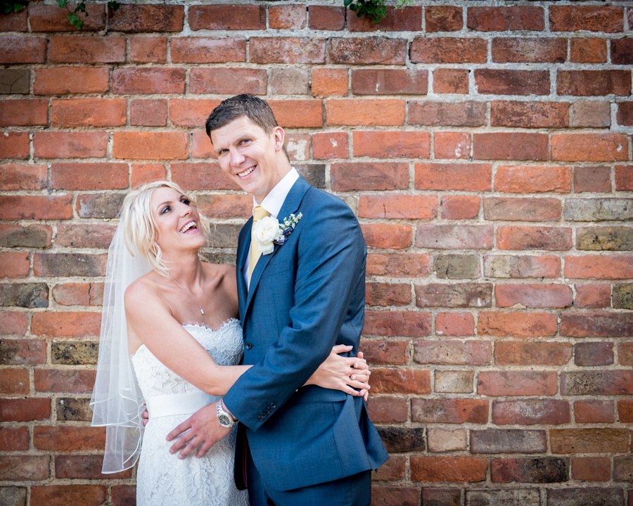 bride, groom, wedding, brick wall, portrait