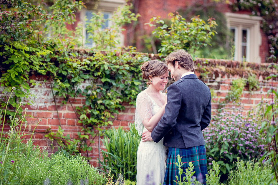 Romantic bride and groom portrait in gardens at Childerley Hall