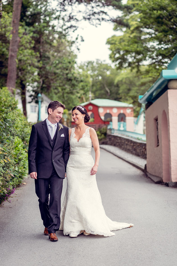 Bride and groom walk down to Portmeirion Hotel