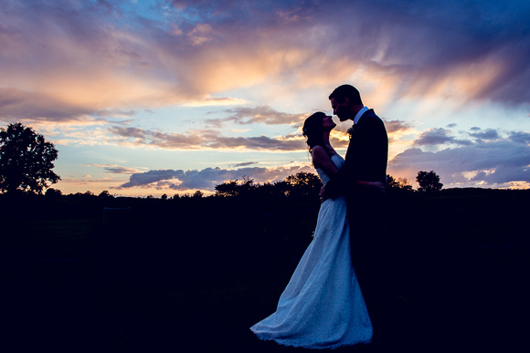 wedding photography at wootton park in warwickshire bride and groom sunset silhouette portrait
