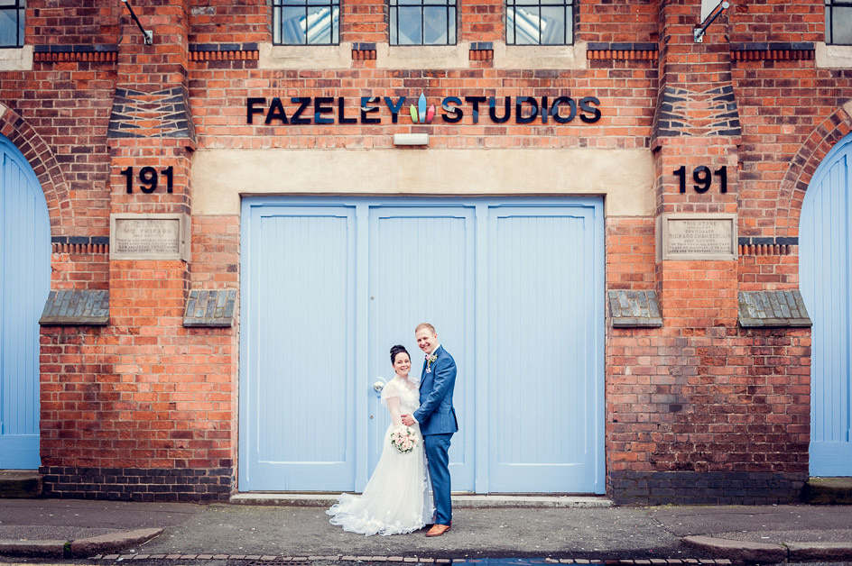 bride and groom portrait outside Fazeley Studios blue doors