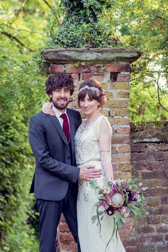 portrait of groom in vintage style suit and bride in Jenny Packham dress at Gorcott Hall near Redditch