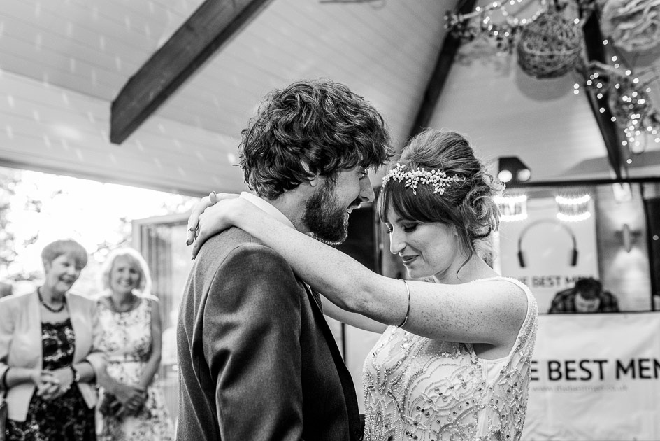 bride and groom's first dance at Gorcott Hall while mums look on
