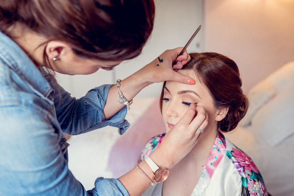 vintage style bridal makeup putting on false eyelashes