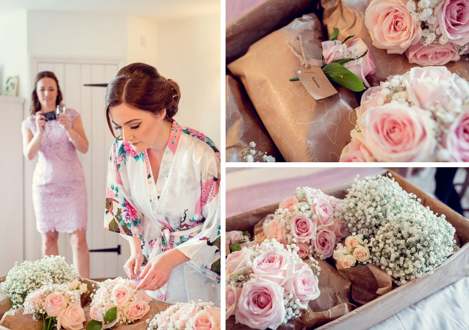 bride looks at flowers pink roses and gypsophila