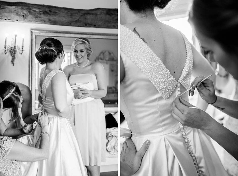 bride putting on fifties style dress at Wootton Park