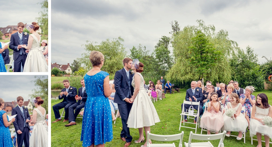 outdoor ceremony on island at Wootton Park  with ring exchange and first kiss