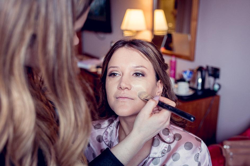 bride having make up applied at Old Thorns
