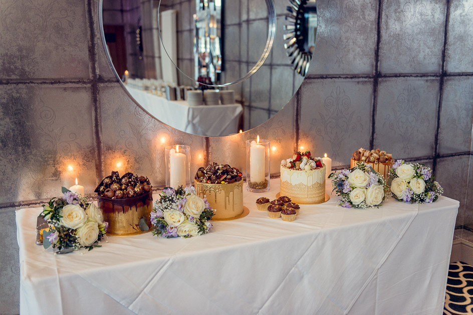cake table with four cakes at Old Thorns