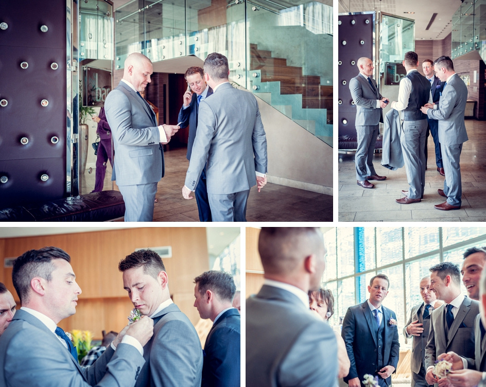 groomsmen getting ready in the foyer at Radisson Blu hotel in Birmingham