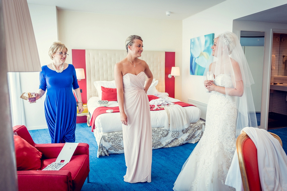 maid of honour and bride's mum look proudly at bride