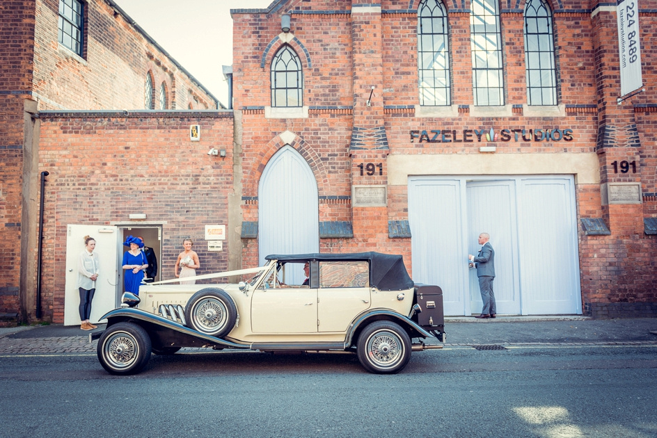 bride arrives at Fazeley Studios in vintage car