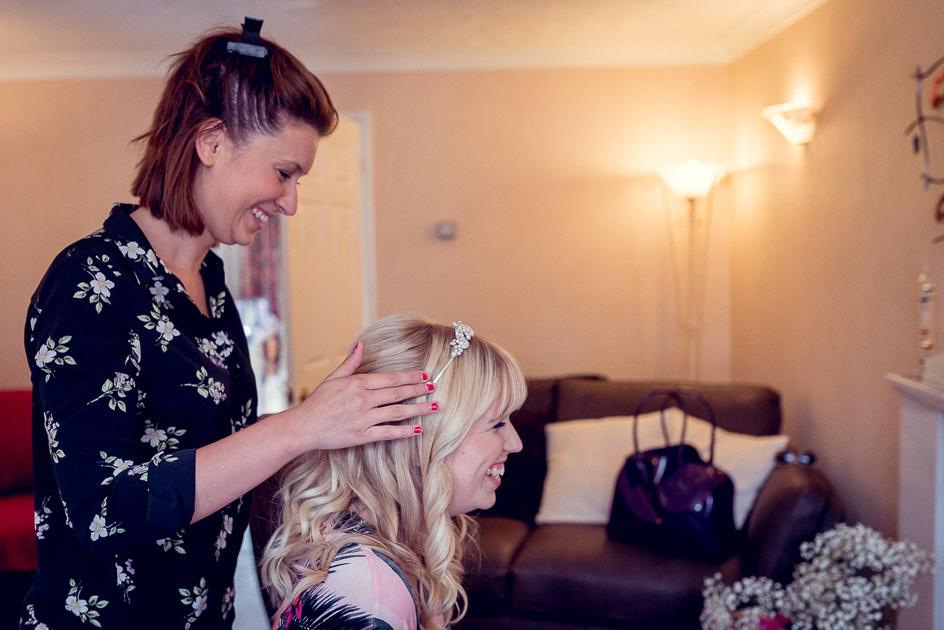 hairdresser putting on brides tiara