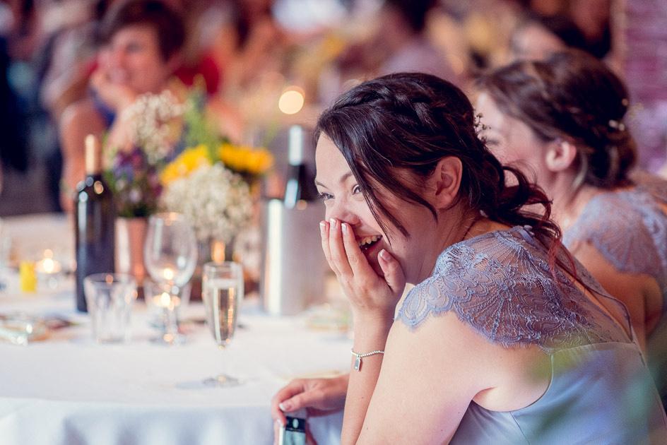 bridesmaid laughs at speech