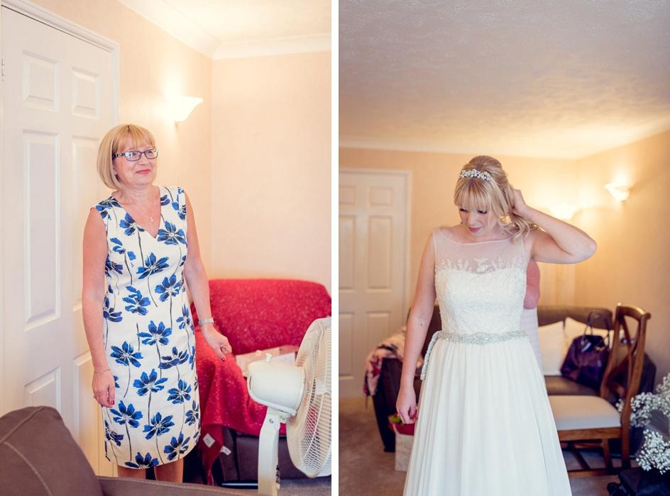 bride's mum looking proud as daughter gets dressed