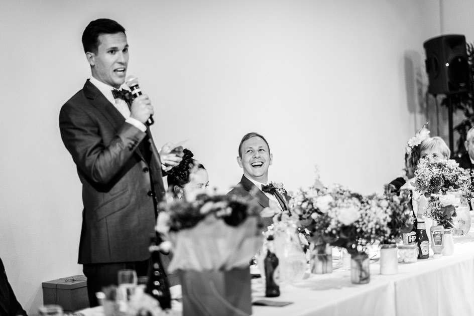 groom laughs at Best Man's speech