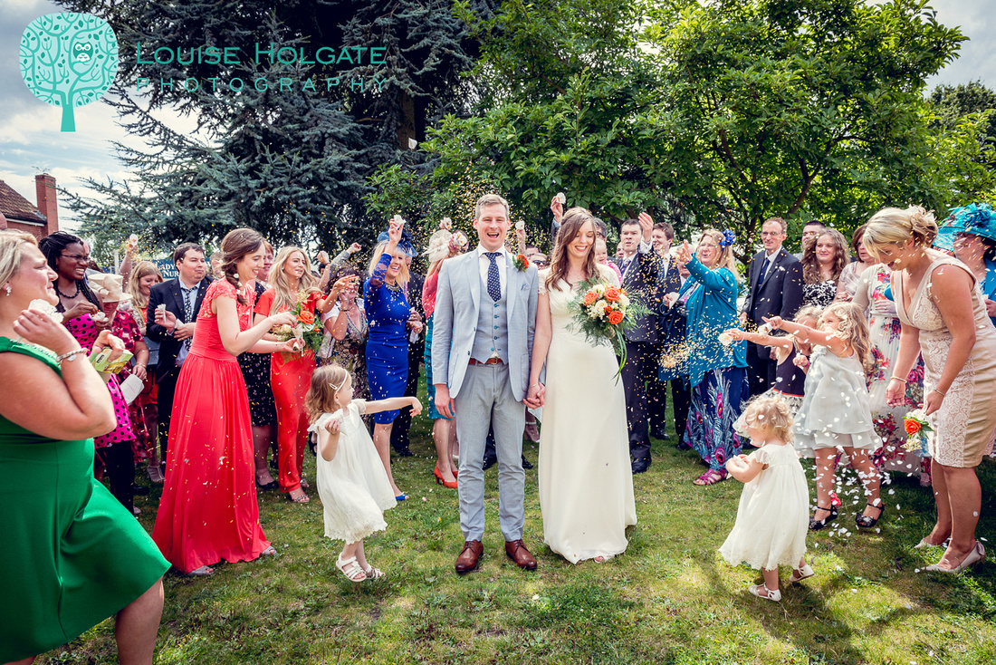 confetti photography at relaxed wedding at Our Lady of the Wayside Church in Solihull
