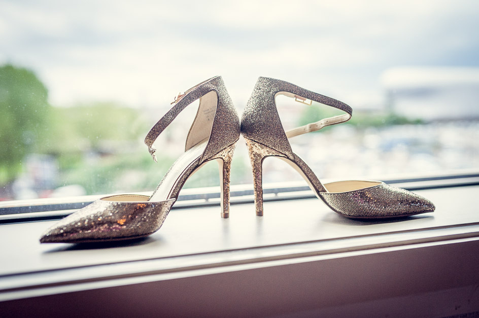 bride's sparkly gold Aldo wedding shoes