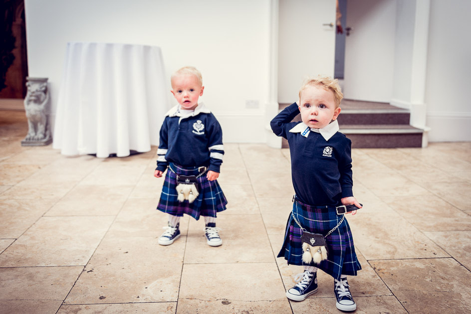 cute page boys in kilts and navy blue Converse