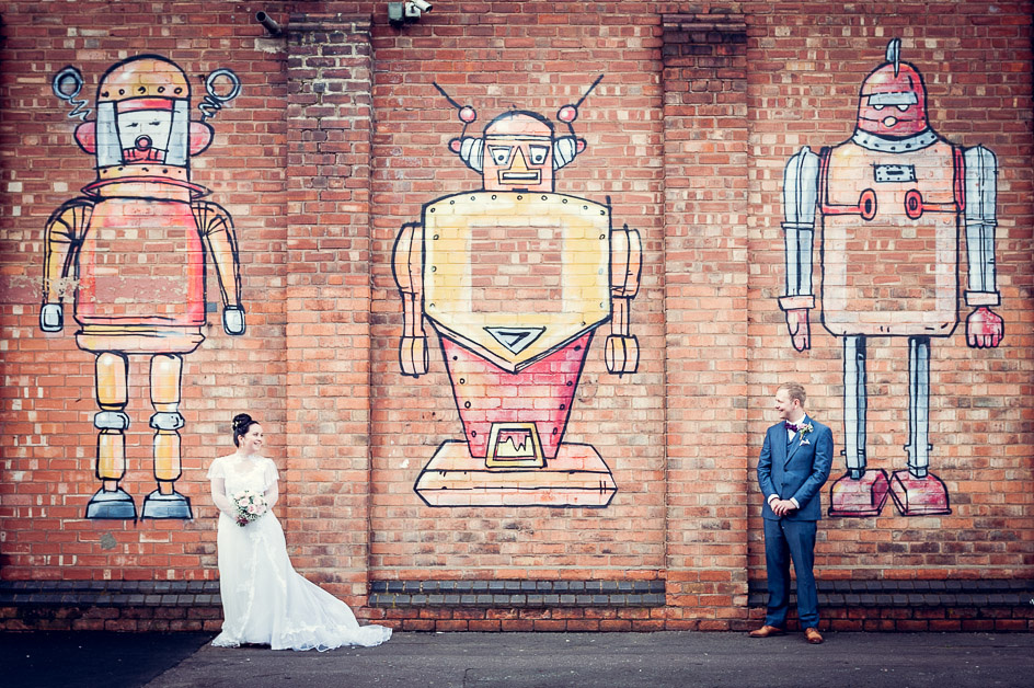 urban bride and groom portrait with robots