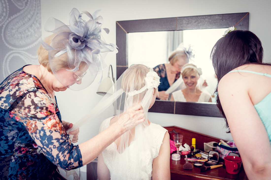 bride's mum adjusts Minna veil