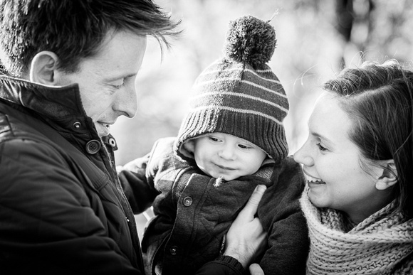 mum and dad with baby in park natural family photography