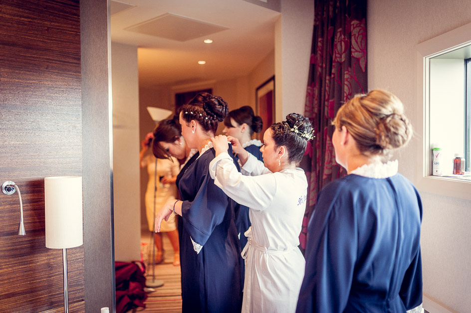 bridesmaids getting dressed at Hotel la Tour