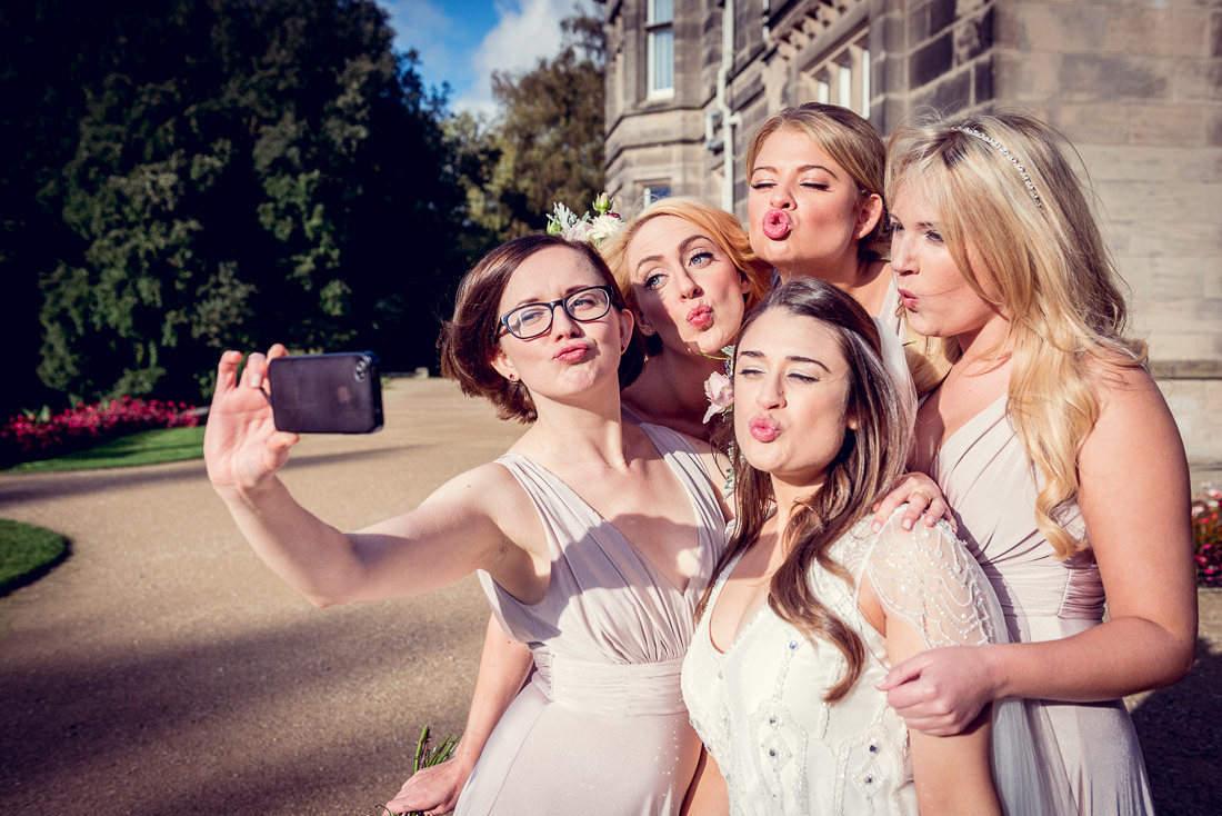 bride and bridesmaid selfie at Hampton Manor