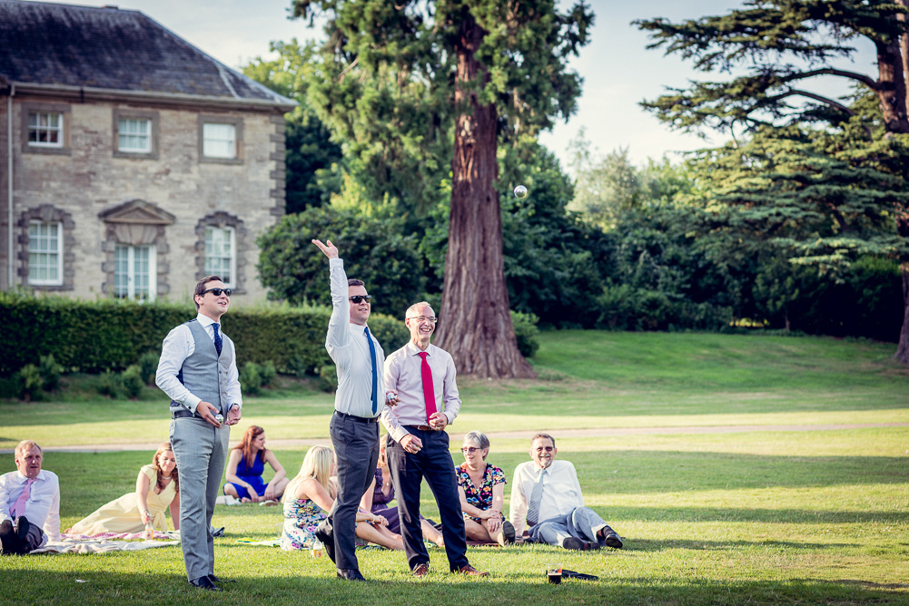 guests playing boules after wedding at Compton Verney