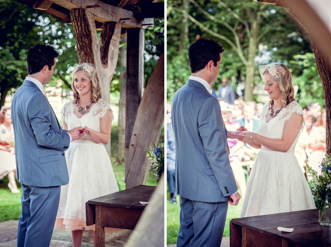 exchanging rings outdoors at Cripps Barn wedding