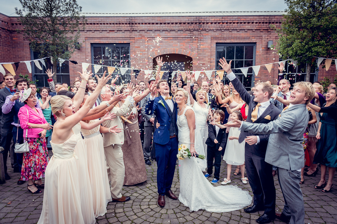 Wedding Photography at Fazeley Studios in Birmingham fun confetti vintage
