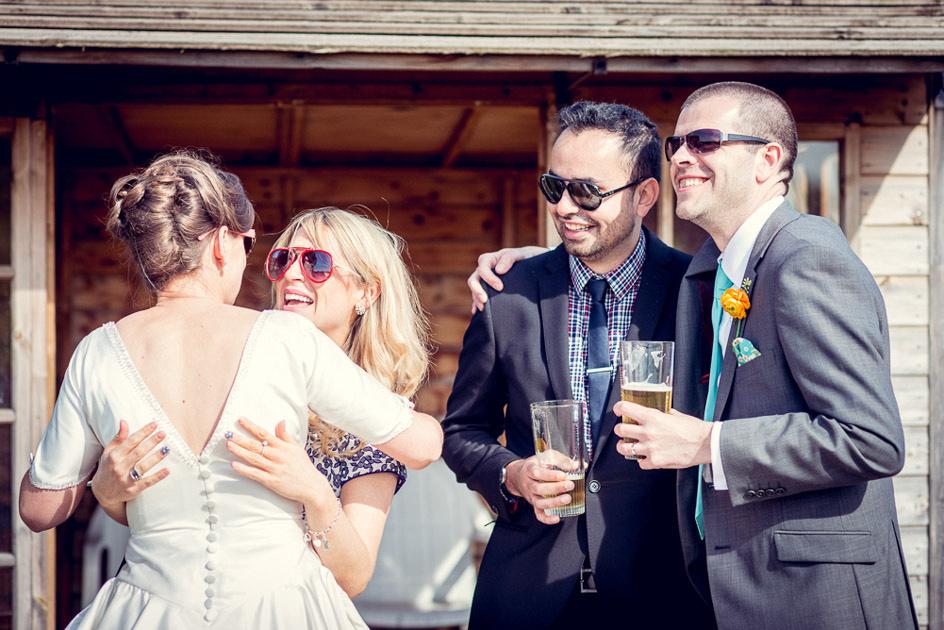 guests congratulating bride and groom