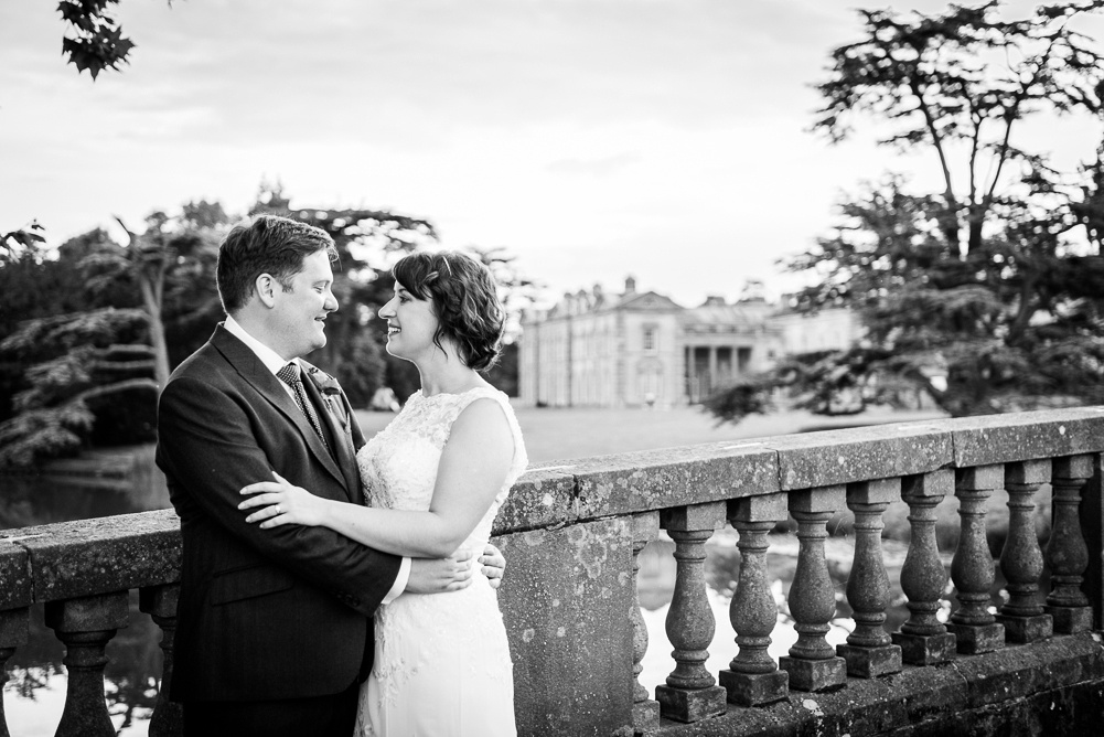 couple portrait on bridge at Compton Verney