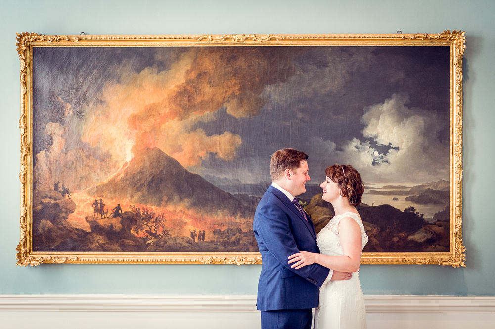 bride and groom with painting at Compton Verney art gallery