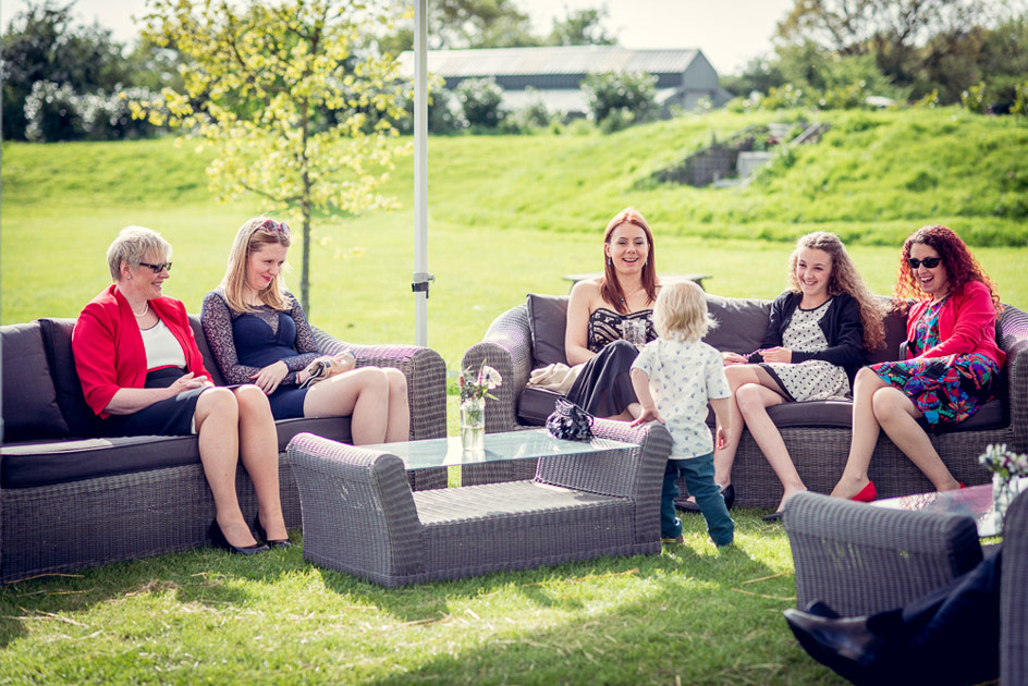 guests relaxing outside at Wootton Park wedding