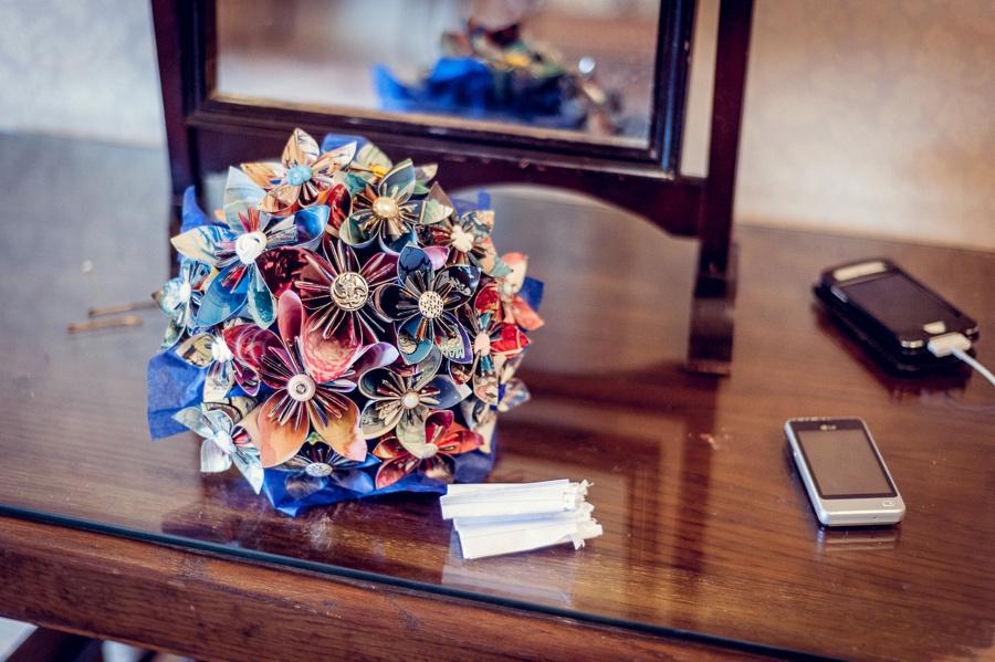 Wedding photography at Highbury Hall in Birmingham bride getting ready pin wheel flower paper button bouquet