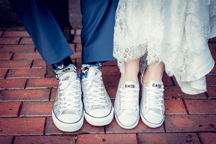 Wedding photography at Highbury Hall in Birmingham bride and groom wearing silver converse all star trainers and batman socks
